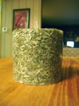 Candle made out of dollar bills